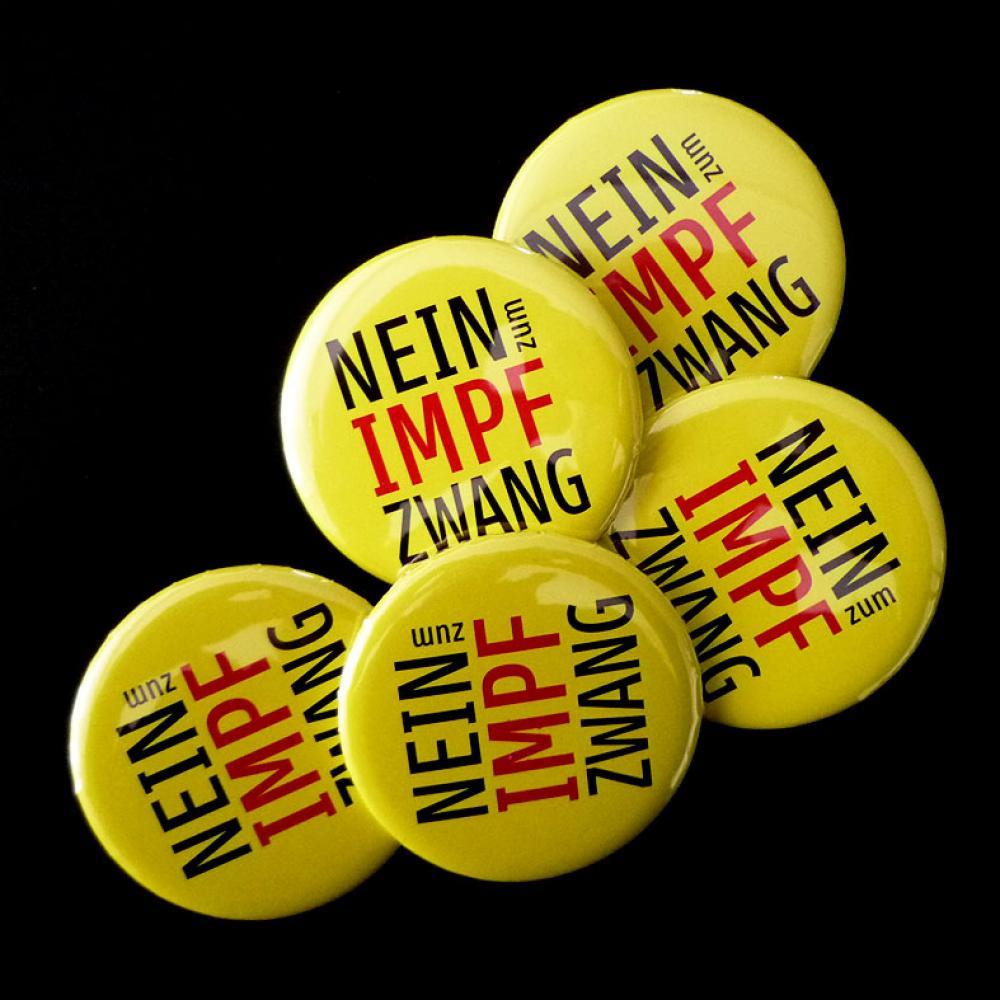 Button: NEIN zum Impfzwang (gelb)