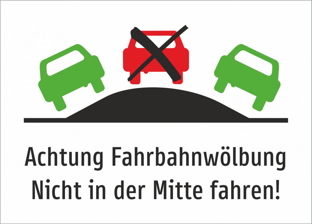 Achtung Fahrbahnwölbung. Nicht in der Mitte fahren!